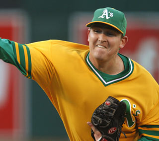 Trevor Cahill has a career outing as he yields two hits with a career-high 10 K's in 7 2/3 scoreless innings.  (AP)