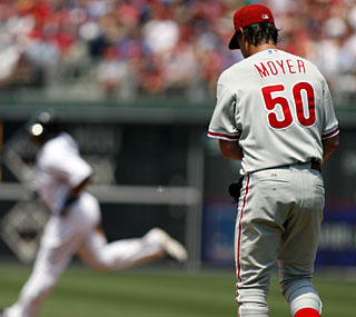 Jamie Moyer makes history by giving up his 506th homer, a two-run shot to Vernon Wells.  (AP)