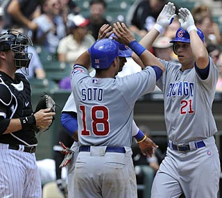 Promising young Cubs outfielder Tyler Colvin comes home after his three-run homer.  (AP)