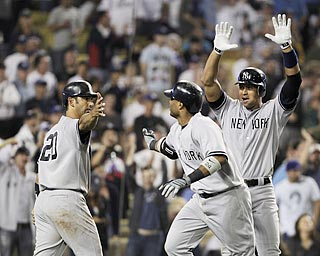 Robinson Cano (center) gets his teammates fired up with his game-deciding home run in the 10th inning.  (AP)