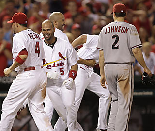 St. Louis celebrates a victory, thanks to three runs in the ninth and a pair of throwing errors by Arizona.  (AP)