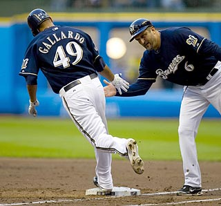 This is old hat for Yovani Gallardo, who now has belted seven home runs in his four-year career.  (US Presswire)
