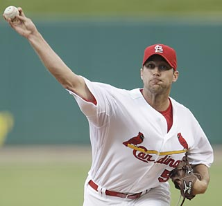 Adam Wainwright extends his MLB-record home streak and beats an NL West team for the first time in 2010.  (AP)