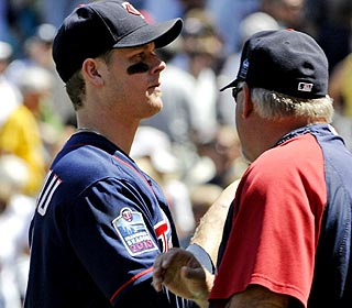 Justin Morneau and manager Ron Gardenhire soak in the win over division rival Detroit. (AP)