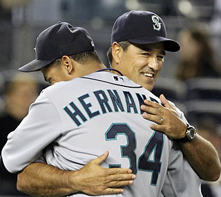 Felix Hernandez gets a well-deserved hug from manager Don Wakamatsu after his dominating performance.  (AP)