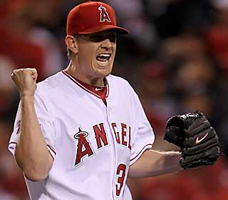 Jered Weaver is pumped up after holding the division-leading Rangers scoreless over seven. (Getty Images)