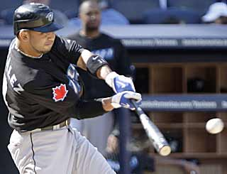 Alex Gonzalez steps up in the 11th and drives in the game-winning run for the Blue Jays. (AP)