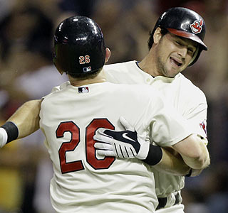 Matt LaPorta (right) gets a hug from Austin Kearns following his game-winning single vs. Oakland. (AP)