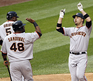 Travis Ishikawa celebrates his third-inning grand slam as the Giants rough up Ubaldo Jimenez.  (AP)
