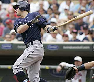 Evan Longoria caps his three-hit game with a two-run single in the Rays' prolific seventh. (AP)