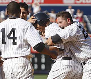 Marcus Thames celebrates the Boss' birthday with a game-winning hit in extras for the Yanks. (AP)