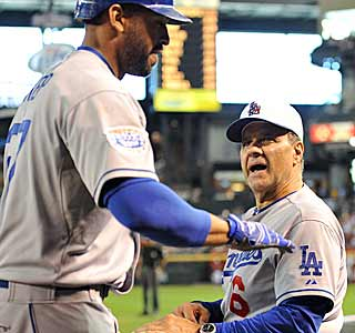 After his two-run shot in the eighth, Matt Kemp is greeted in the dugout by manager Joe Torre. (AP)