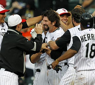 Todd Helton sends the Rockies and their fans home happy with his game-winning RBI in the 15th inning.  (AP)