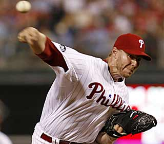 Roy Halladay allows five hits and strikes out seven during his second straight complete game. (AP)