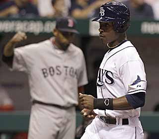 B.J. Upton comes across in the seventh on the sacrifice fly for what ends up being the deciding run. (AP)