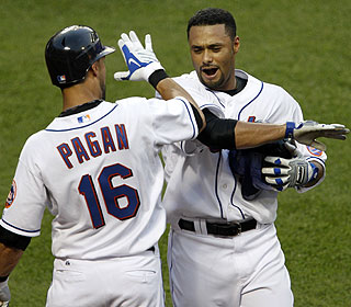 Johan Santana celebrates the win in which he hits his first major-league HR and fires his first shutout since '08. (AP)
