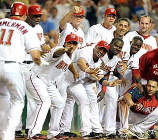 The Nationals wait for Ryan Zimmerman following his game-winning solo shot in the ninth.  (Getty Images)