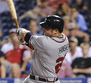 Eric Hinske adds a couple of insurance runs in the 11th with this two-run homer. (US Presswire)