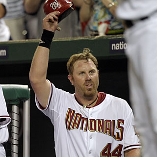 Adam Dunn tips his hat to an appreciative crowd after his third home run of the game. (AP)