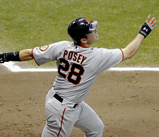 Buster Posey, who homers in the first inning, follows it up with his first career grand slam.  (AP)