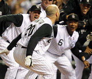 Another wild ninth-inning finish for the Rockies. This time it's Chris Iannetta fueling the walk-off-style win.  (AP)