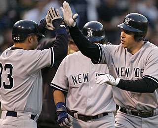 Welcome to the plate, Nick Swisher says to Mark Teixeira, who hits a three-run home run. (AP)