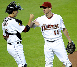 Roy Oswalt (right) yields only a first-inning single in his shutout and posts his first home win since April 23. (AP)