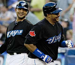 It's all smiles for Jose Molina (right) after he smashes one of the Blue Jays' five homers against the Twins. (AP)