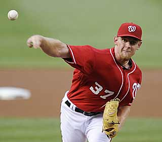 Eight runs is more than enough as Stephen Strasburg only gives up one earned run over six-strong innings. (AP)