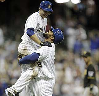 Ryan Braun catches a ride on Prince Fielder after producing the game-winning hit for the Brewers. (AP)