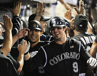 Lots of reasons for Ian Stewart to celebrate: 3rd career slam, 4th multihomer game and career-best 6 RBI. (AP)
