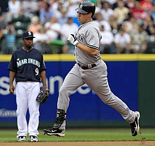 Mark Teixeira takes a casual stroll around the bases after smacking a home run in the first inning. (AP)