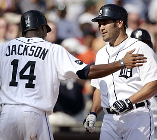 Johnny Damon knocks a three-run homer to help the Tigers win their fifth straight game.  (AP)
