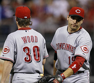 Joey Votto gives Travis Wood some solace after Wood's bid for a perfect game ends in the ninth.  (AP)