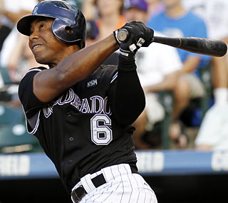 Melvin Mora belts one of Colorado's three home runs as the Rockies move into second place in the NL West.  (AP)