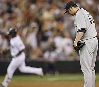 A dejected Joba Chamberlain watches Jose Lopez trot around the bases after his grand slam. (AP)