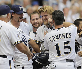 The Brewers surround game hero Corey Hart, whose home run in the ninth helps Milwaukee sweep Pittsburgh.  (AP)