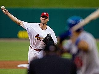 Chris Carpenter goes seven scoreless, eight in total, to improve to 6-0 against the Dodgers. (Getty Images)