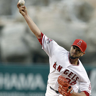 Joel Pineiro allows just six hits over seven innings of work to earn his 10th win of the season. (AP)