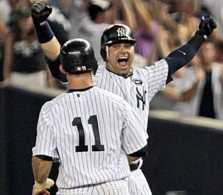 Nick Swisher ties the game with a late homer and then wins it with a walk-off single in the ninth. (AP)