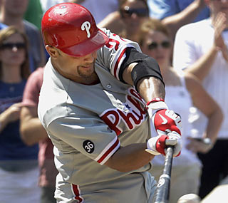 Placido Polanco makes his presence felt in his return as his RBI single ties it in the ninth inning. (AP)