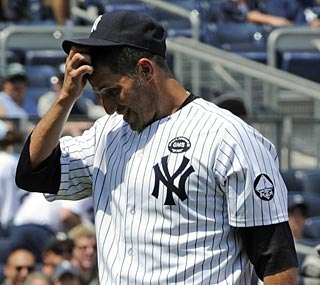 Andy Pettitte exits during the third inning against the Rays and will miss at least a month.  (AP)