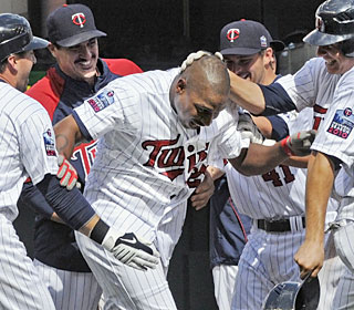 The Twins move within 1 1/2 games of first-place Chicago after Delmon Young's walk-off single.  (AP)