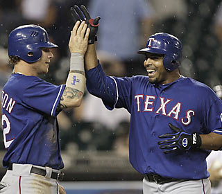 The Rangers' Josh Hamilton and Nelson Cruz hurt the Tigers with a combined seven hits and five RBI.  (AP)