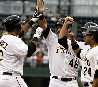 Rookie Pedro Alvarez hits a grand slam and a solo shot for the first multi-homer game of his career.  (AP)