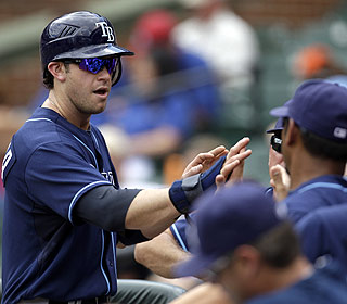 Evan Longoria gets praise after scoring one of his two runs. He also has homers and drives in two. (AP)