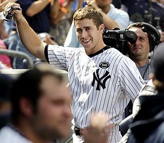 Rookie Colin Curtis takes a curtain call after hitting his first HR -- a 3-run shot -- as a pinch-hitter. (AP)