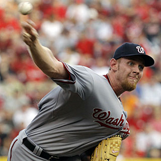 Rookie sensation Stephen Strasburg whiffs seven and gives up three runs on seven hits for his fifth win. (AP)