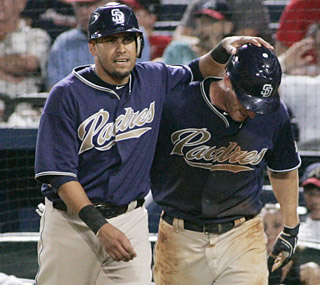 Oscar Salazar and Chris Denorfia each score in the 12th to put the Padres ahead for good. (AP)
