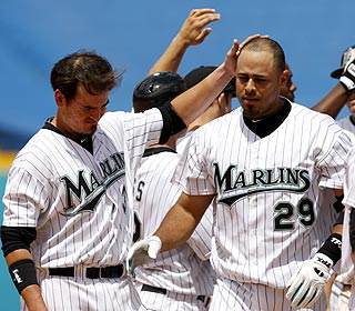 Ronny Paulino (29) is the hero as the Marlins win in dramatic fashion for the second time in the series. (AP)
